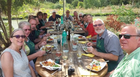 Cooking by The Canal du Midi: Happy cooks and guests enjoying our efforts!