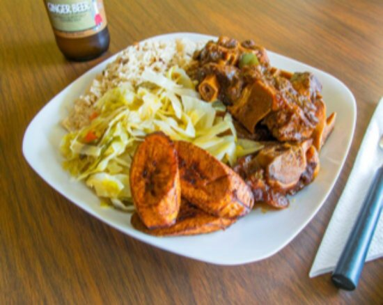 East Orange, NJ: Oxtail, rice and peas and cabbage. Best Seller!!