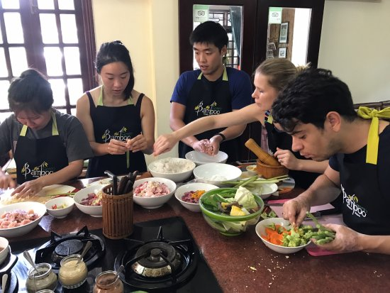 Green Bamboo Cooking School & Cafe: Everyone super-engaged at the cooking studio. These are challenging dishes--you will earn your k