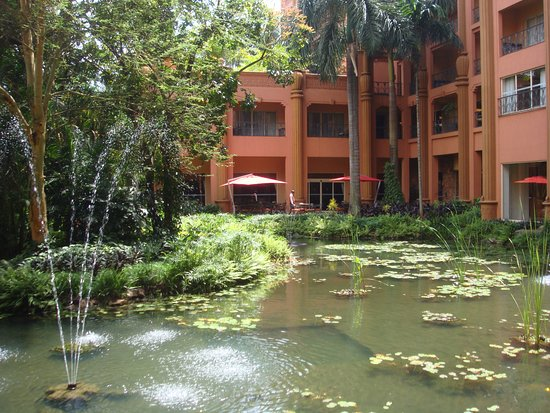 Kampala Serena Hotel: The pond attracts lots of birds, sights and sound enjoyed by guests
