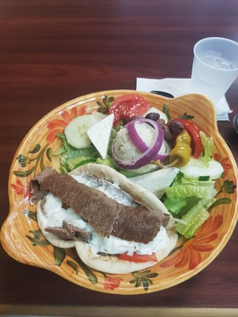 Riverview, FL: Gyro Greek Salad -- a gyro served on top of a Greeek salad, with a scoop of potato salad.