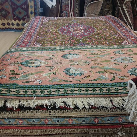 Bristol, VT: Carpets piled high, at Oriental Rugs of Bath