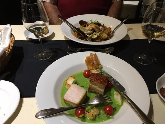 Castel, UK: Bouillabaise & Pork Belly with Scallops