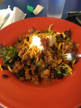 Nani's Restaurant: This colorful spring green salad is topped with delicious, tangy Picadillo, beans, sour cream an