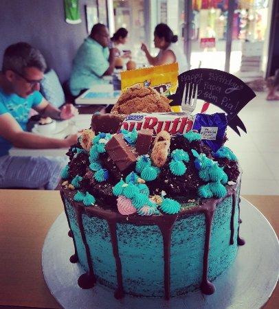 Blue chocolate drizzle birthday cake Picture of Milani Caffe Samoa