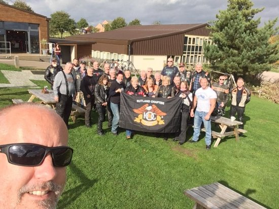 Leicestershire, UK: The Rutland Chapter of HOG (Harley Owners' Group) lapping up the sunshine at Ventoux ...