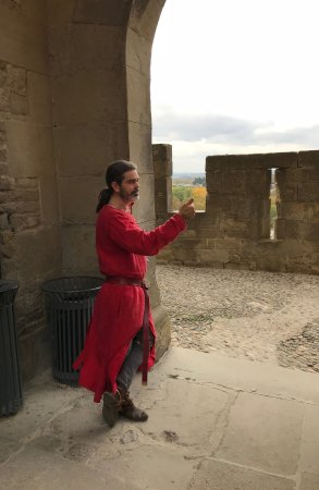 Carcassonne Center, France : Jeff explaining Carcassonne's history, dressed in clothing fitting to the town's time.