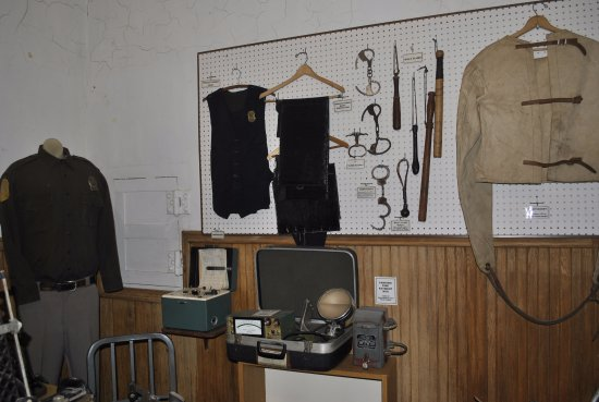 Neillsville, WI: Attached Clark County Jail - Vintage law enforcement items on display.