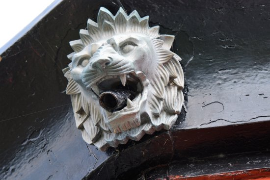 Dunkirk, NY: Lions head drainage spout.