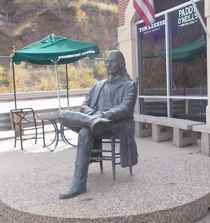 Deadwood, SD: statue on the patio outside the Hampton Inn