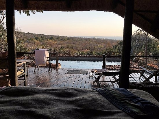 Victoria Falls, แซมเบีย: Honeymoon suite, view from the bed