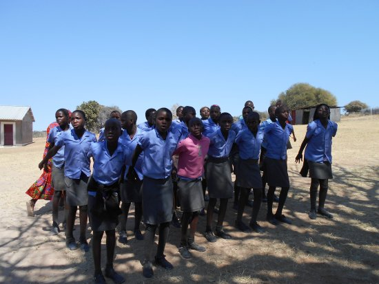 Rundu, Namibia: Chior singing farewell following a morning visit