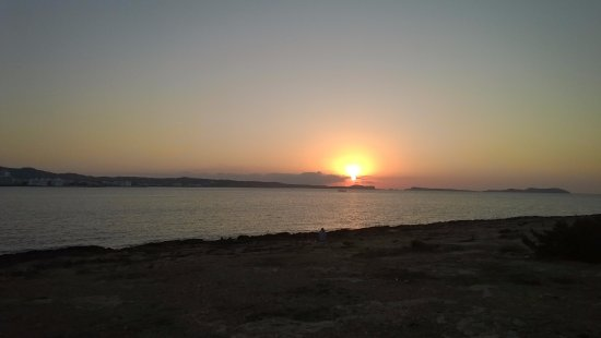 Amistat island Hostel Ibiza view of sunset from beach area, 5 minutes walk from hotel.