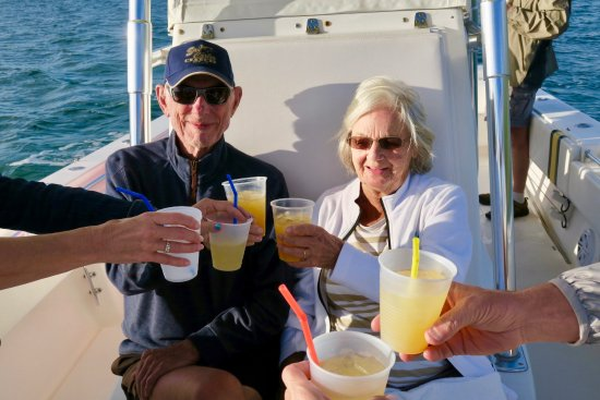 Green Turtle Cay: Wade had beverages onboard for us :) Happy 65th Anniversary to this couple