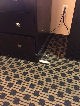 Econo Lodge: wedged under dresser to keep level.