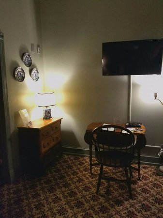 The Black Hawk Hotel: Sitting area, desk, and antique dressers