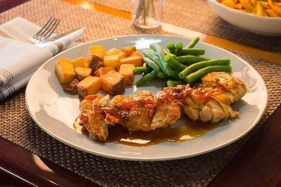 Maxine's: Boneless crispy skin chicken thighs. Orange honey glaze