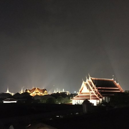 Sala Arun : view of Wat Pho on the right and the Grand Palace on the left from rooftop bar