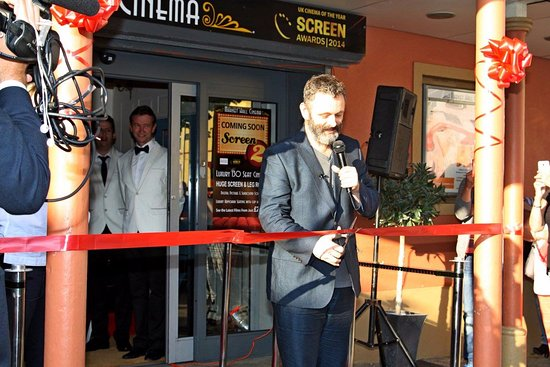 Ebbw Vale, UK: Hollywood star Michael Sheen cuts the ribbon to officially re-open the Cinema in July 2017