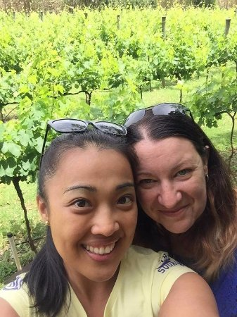 Gold Coast, Australia: The bestie and I in front of vineyard at Witches Falls Winery