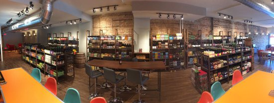 Park Ridge, IL: Photo from the bar showing retail beer selection--lounge areas available in front and back.