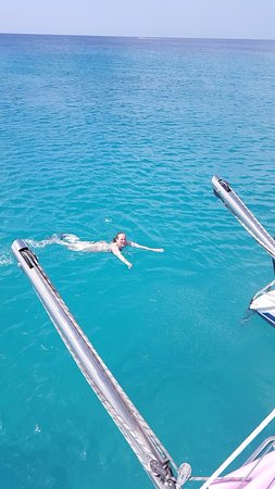 Elegance Catamaran Cruises: Look at the water. Kelly found a great secluded place