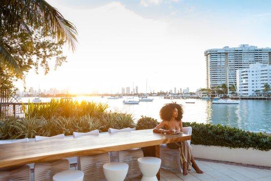 Miami Beach, FL: Await your treatment at our outdoor patio having a fresh brewed organic tea.