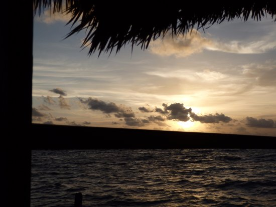 Barefoot Beach Belize: View of sunset from hammocks on pier
