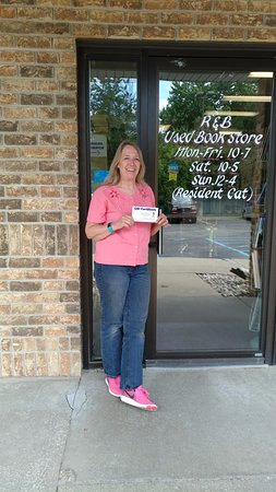 Grand Blanc, MI: Owner Beth Dumity holding a prize for a special winner!