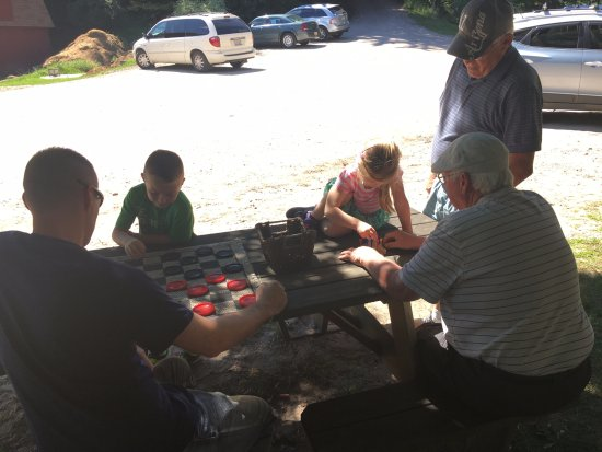 ‪‪Frankfort‬, ميتشجان: My husband and kiddos playing games with locals.‬