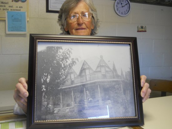 Jasper, AR: Mrs. Ruth holding a pic of her home.