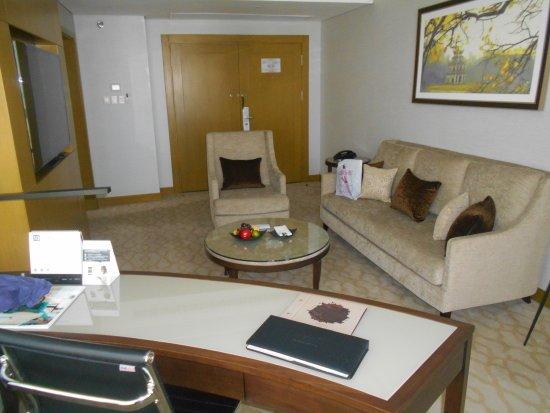Melia Hanoi: The sitting and work area of Room 1819