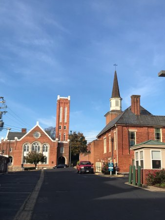 Staunton, VA: Two prominent buildings on street in sunrise