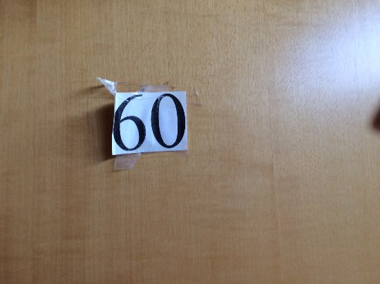 Hotel Eden: Room number stuck on with sellotape.
