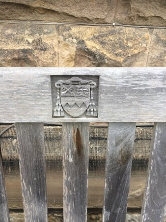 Ampleforth, UK: Wood carving on one of the garden seats