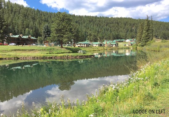 Bailey, CO: Our trout pond with the lodge on the left.