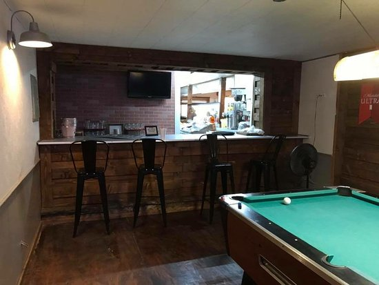 Small bar area with pool table. Serves beer and wine. - Picture of ...