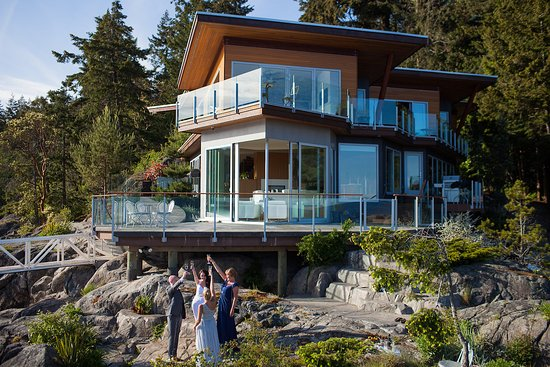 Halfmoon Bay, Canada: Wedding couple enjoying a celebratory toast with family after an relaxed elopement.