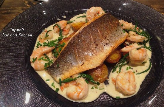 Littleborough, UK: Sea bass. Harissa potatoes. Tiger prawn & samphire sauce.