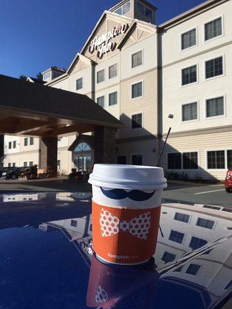 Hampton Inn Littleton : Hampton Mustache with Coffee near entrance