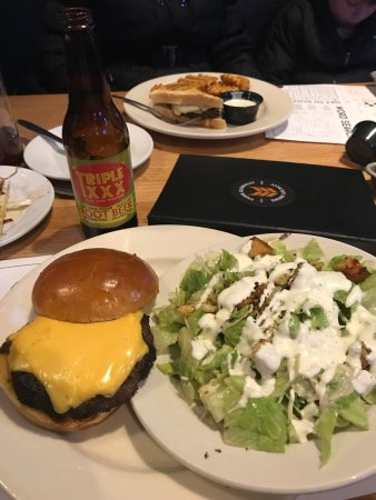 Noblesville, IN: Triple X root-beer, a Juicy Lucy Burger, and a side Caesar salad.  And for dessert, Peanut butte