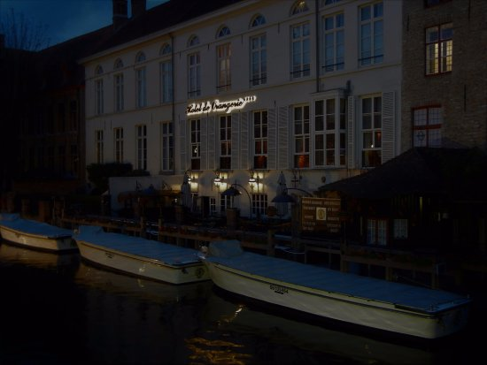 Hotel de Orangerie: hotel exterior rear - along the canal at dusk