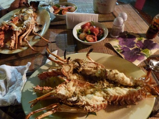 Tobago Paradise Travel and Grill: They call it lobster I call it crayfish...whichever it was delicious.