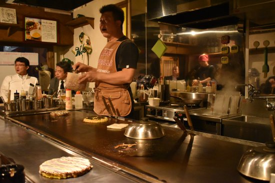 Okonomiyaki made fresh and piping hot on the grill right in front of you at Nakano's Tonikaku