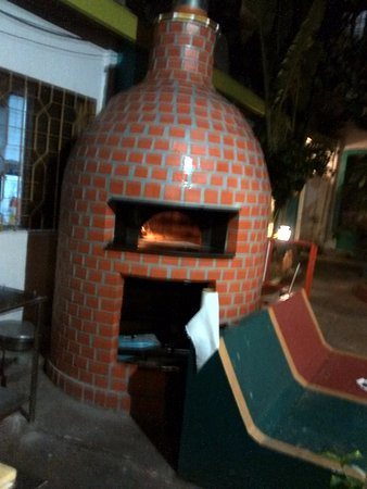 wood fired oven for pizza making picture of le club pondicherry