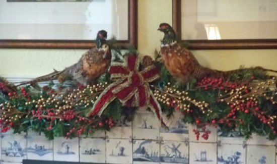 Chester Heights, PA: Pheasant help decorate the mantle in the billiard room.