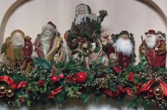 Chester Heights, PA: Antique Santas decorate the reception room's mantle.