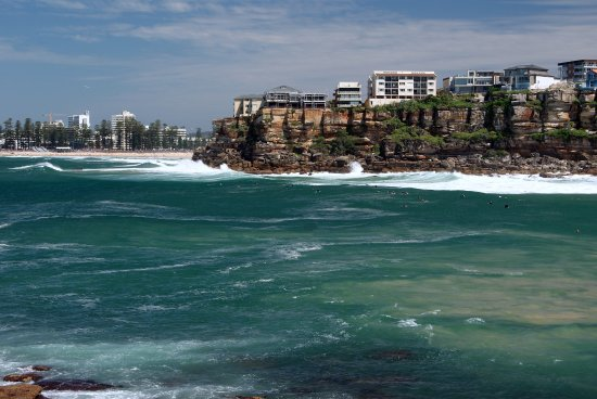 the southern headland of Freshwater Beach with Manly Beach in the background