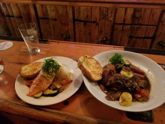 Centennial, WY: Sesame Salmon and Pot Roast served at the bar. Great tasting and huge proportions.