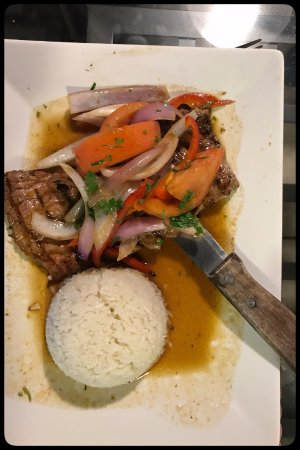 Belleview, FL: Churrasco Chorrillana served with sauteed onions and tomato and spices.